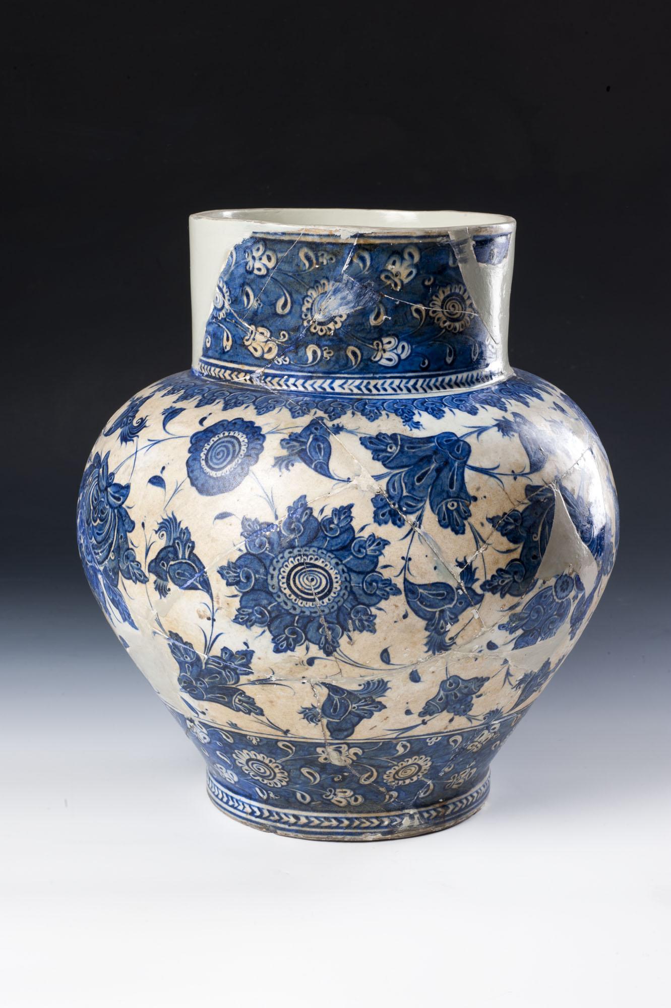 Ceramic jug with animal figures,
